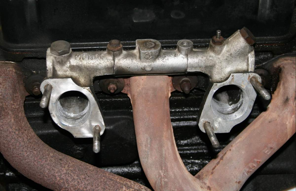 Manifold openings enlarged.